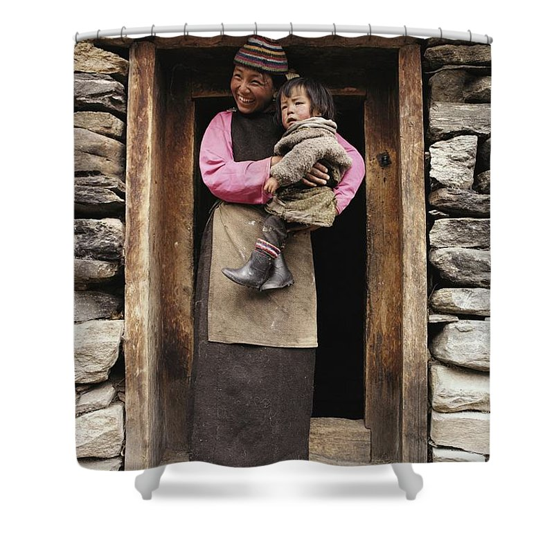 Asia Shower Curtain featuring the photograph A Smiling Bhutanese Woman And Child by Paul Chesley