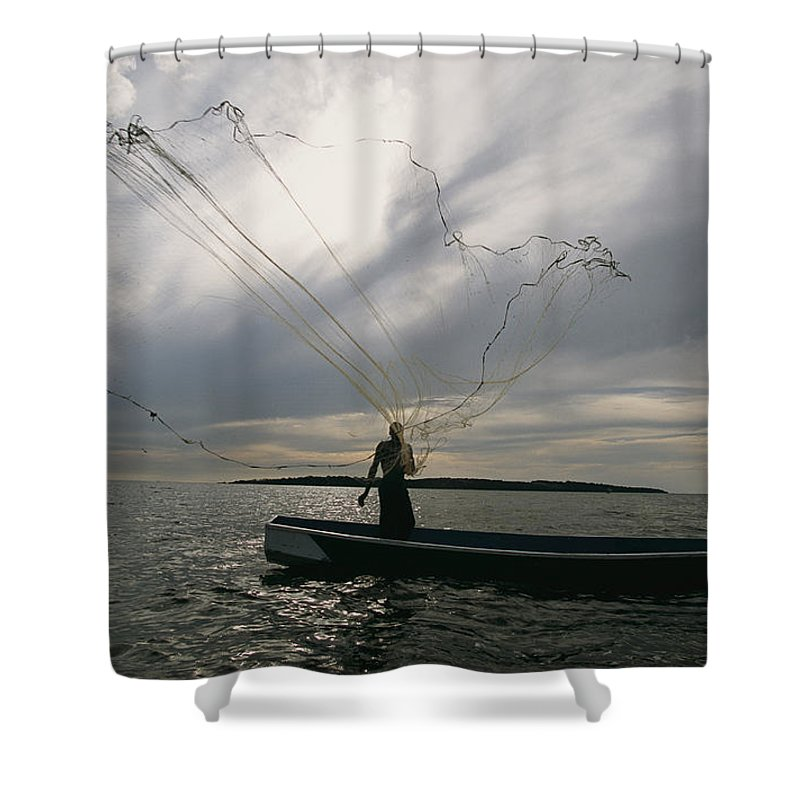 Africa Shower Curtain featuring the photograph A Ugandan Man Casts A Fishing Net by Michael S. Lewis