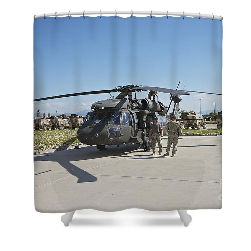 Operation Enduring Freedom Shower Curtain featuring the photograph A Uh-60l Blackhawk Parked On Its Pad by Terry Moore