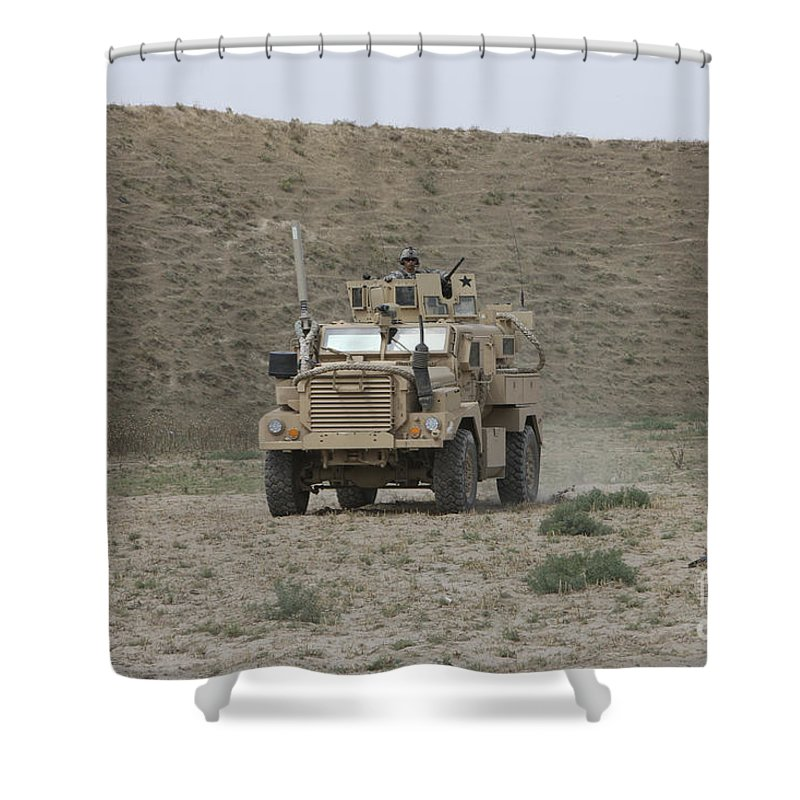 Mrap Shower Curtain featuring the photograph A U.s. Army Cougar Patrols A Wadi by Terry Moore