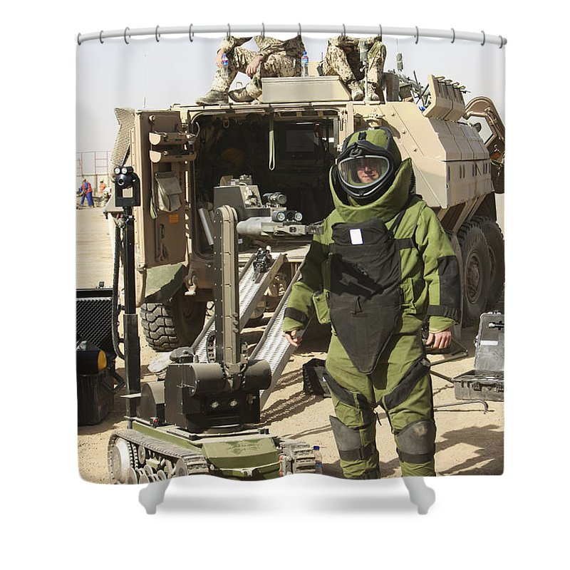 Kunduz Shower Curtain featuring the photograph A U.s. Marine Dressed In A Bomb Suit by Terry Moore