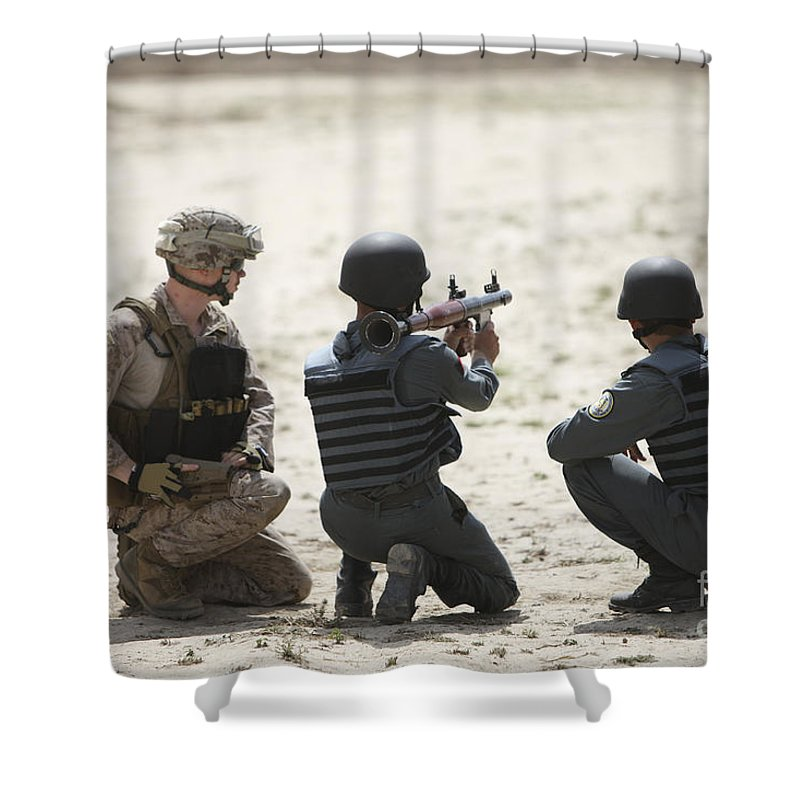 Afghanistan Shower Curtain featuring the photograph An Afghan Police Student Prepares by Terry Moore