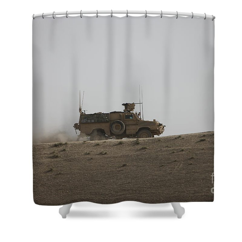 Operation Enduring Freedom Shower Curtain featuring the photograph An Mrap Vehicle Patrols The Ridge by Terry Moore