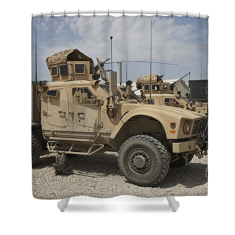 Afghanistan Shower Curtain featuring the photograph An Oshkosh M-atv Parked At A Military by Terry Moore