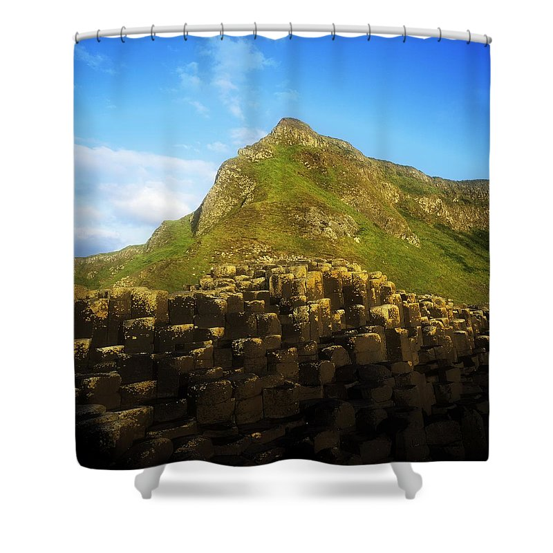 Basalt Shower Curtain featuring the photograph Basalt Rock Formations Near A Mountain by The Irish Image Collection
