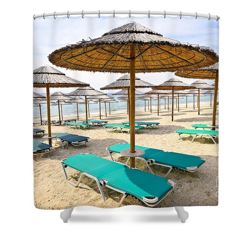 Beach Shower Curtain featuring the photograph Beach Umbrellas On Sandy Seashore by Elena Elisseeva