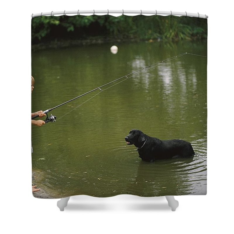 North America Shower Curtain featuring the photograph Boy Fishing In A Pond With A Black by Brian Gordon Green