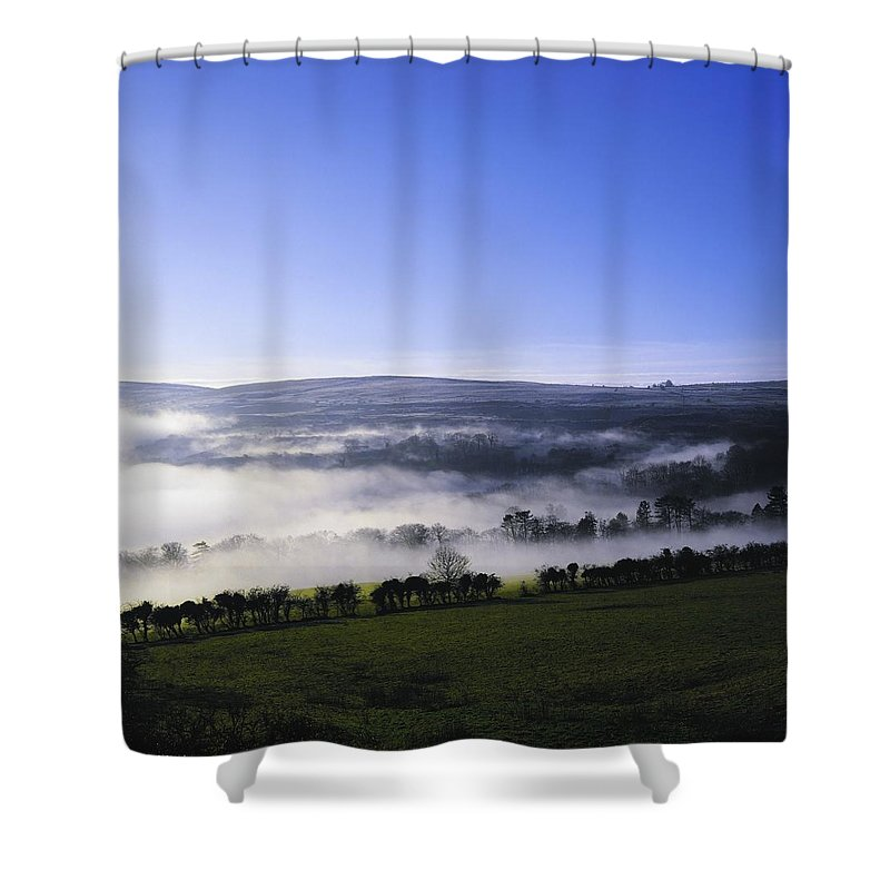 Back Lit Shower Curtain featuring the photograph Co Antrim, Ireland Mist Over A Landscape by The Irish Image Collection