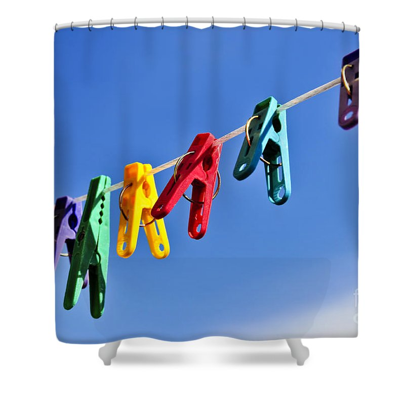 Clothes Shower Curtain featuring the photograph Colorful Clothes Pins by Elena Elisseeva