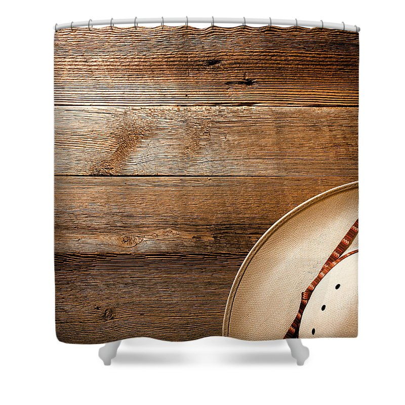 Aged Shower Curtain featuring the photograph Cowboy Hat On Wood by Olivier Le Queinec