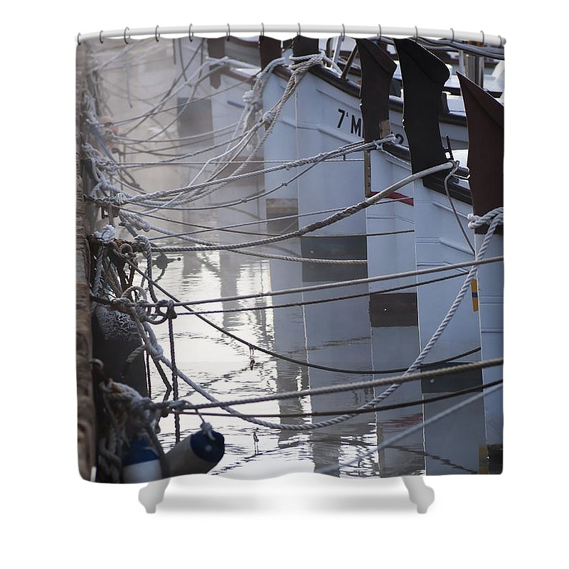 Nobody Shower Curtain featuring the photograph december's cold morning - A foggy day in port mahon with a line of traditional llaut boats by Pedro Cardona Llambias