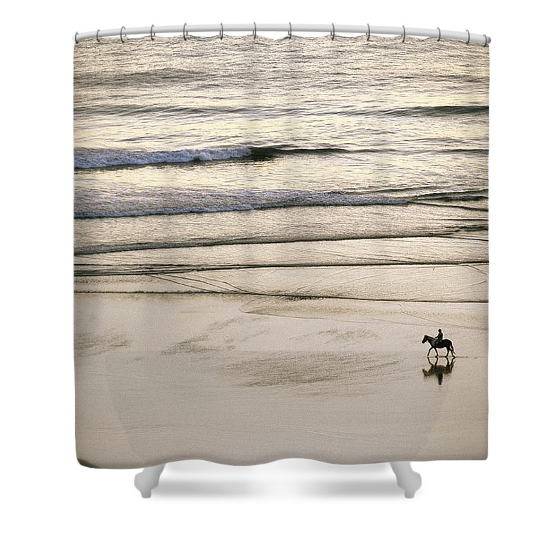 Gold Beach Shower Curtain featuring the photograph Elevated View Of A Horseback Rider by Phil Schermeister