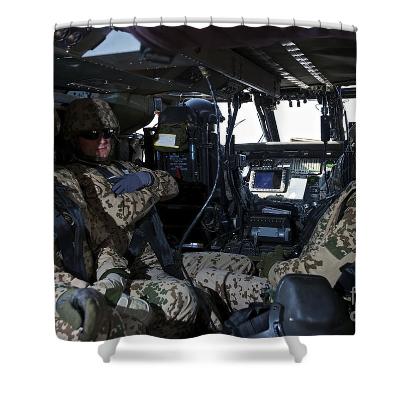 Cockpit Shower Curtain featuring the photograph German Soldiers Seated In A Uh-60l by Terry Moore