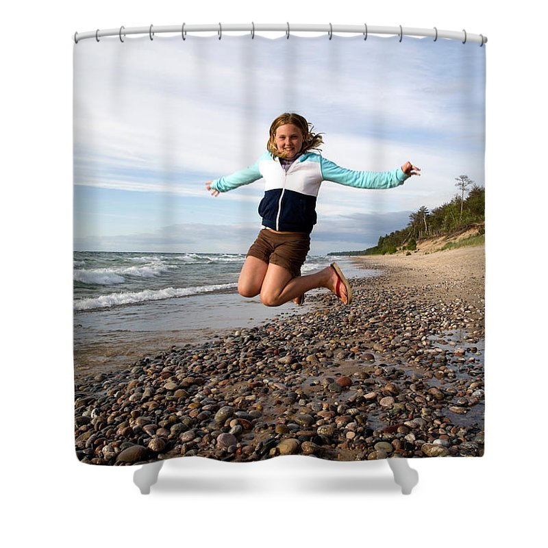 Jump Shower Curtain featuring the photograph Girl Jumping At Lake Superior Shore by Ted Kinsman
