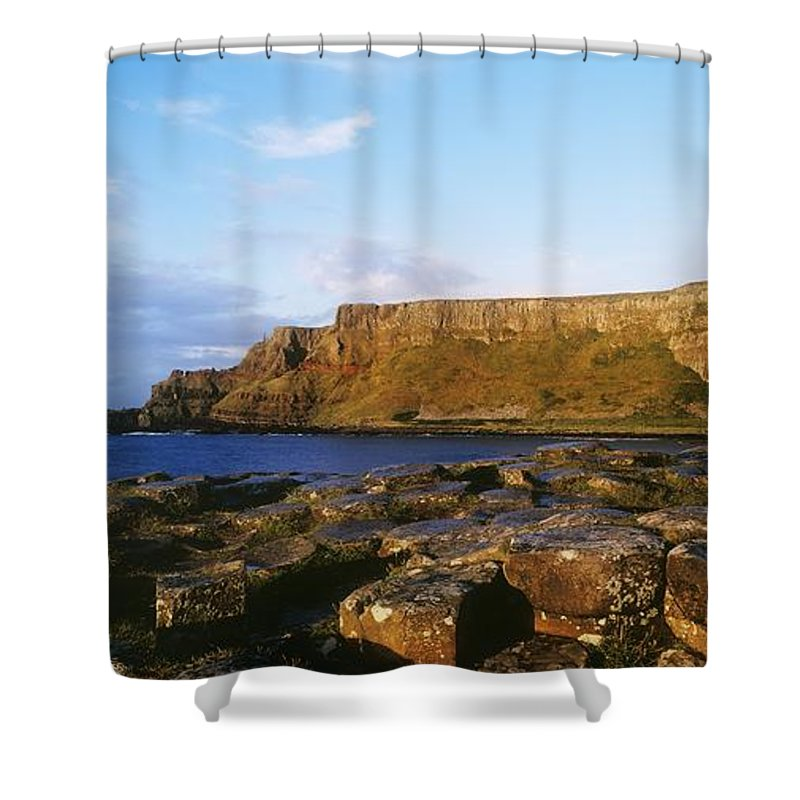 Basalt Shower Curtain featuring the photograph High Angle View Of Rocks, Giants by The Irish Image Collection