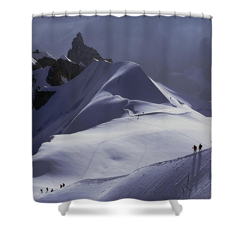 Alps Shower Curtain featuring the photograph Hikers Follow Paths Across The Snow by Paul Chesley