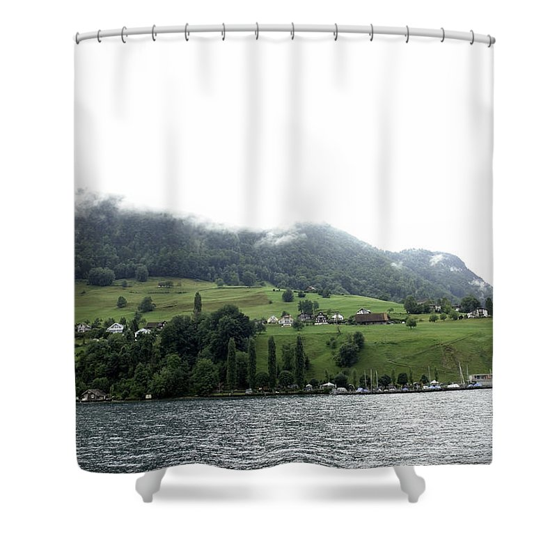 Action Shower Curtain featuring the photograph Houses On The Greenery Of The Slope Of A Mountain Next To Lake Lucerne by Ashish Agarwal