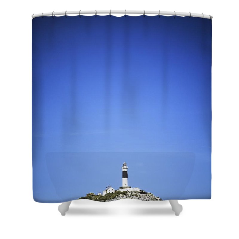 Blue Shower Curtain featuring the photograph Lighthouse In The Sea, Rockabill by The Irish Image Collection