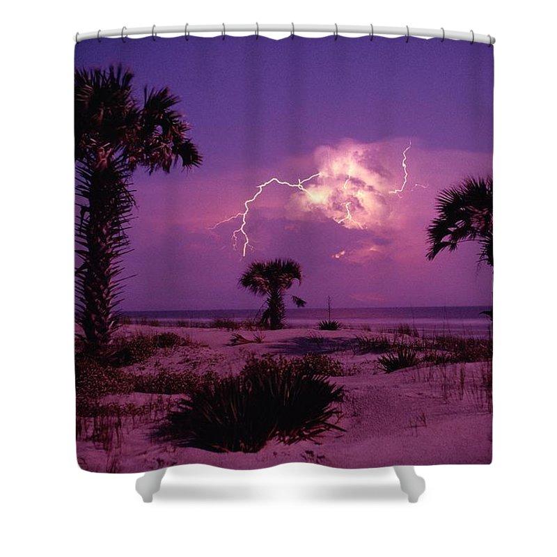 Cumberland Island National Seashore Shower Curtain featuring the photograph Lightning Illuminates The Purple Sky by Raymond Gehman