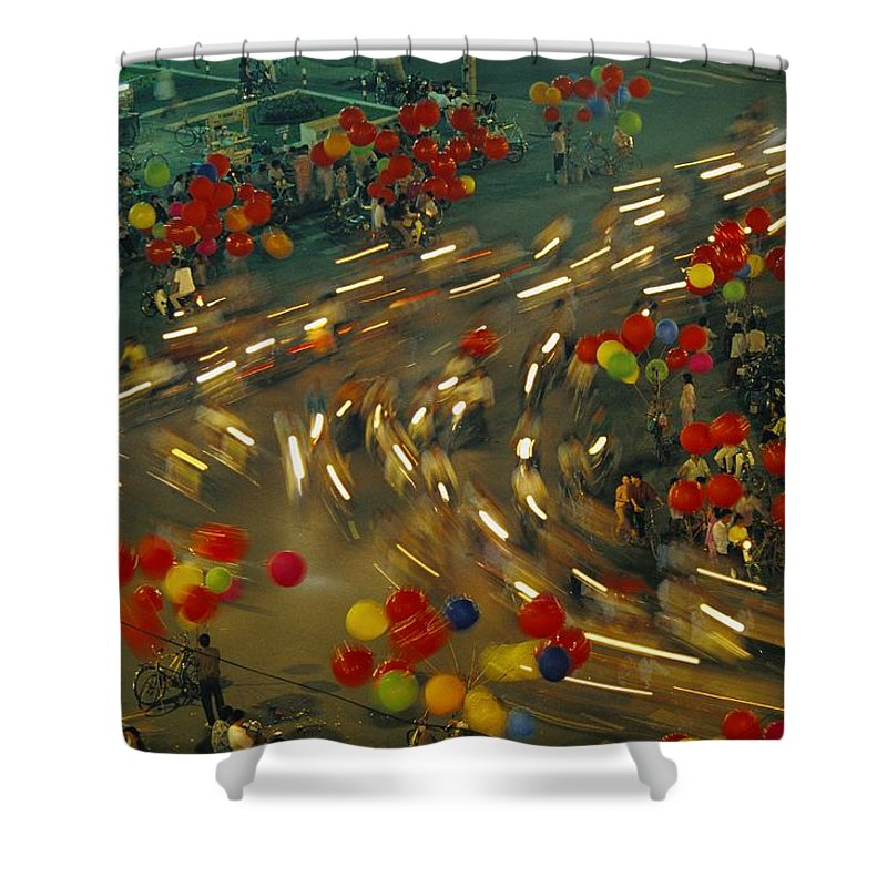 Balloons Shower Curtain featuring the photograph Motobikes Race Along A Street by Paul Chesley