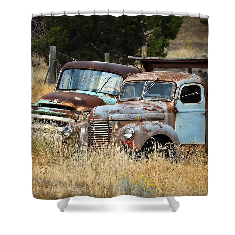 Dually Shower Curtain featuring the photograph Old Farm Trucks by Steve McKinzie