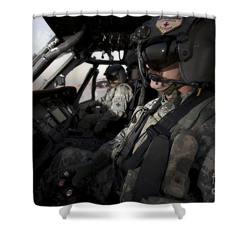 Cockpit Shower Curtain featuring the photograph Pilot In The Cockpit Of A Uh-60l by Terry Moore