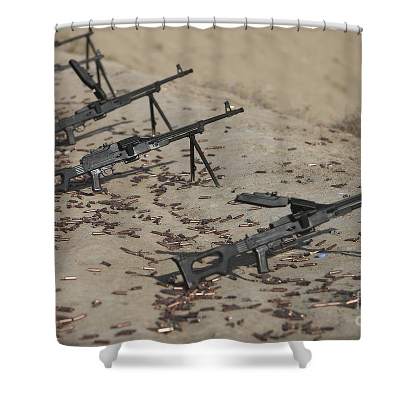 Kunduz Shower Curtain featuring the photograph Pk Machine Guns And Spent Cartridges by Terry Moore