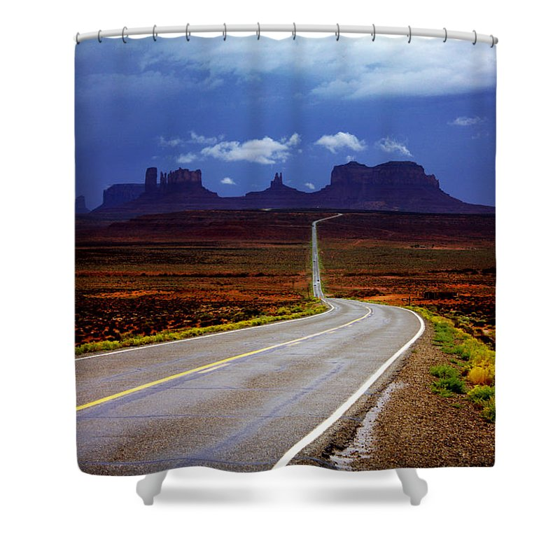 Monument Valley Shower Curtain featuring the photograph Rainclouds Over Monument Valley by Ellen Heaverlo