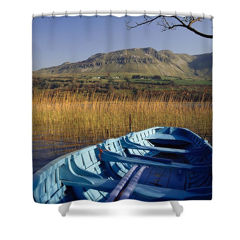 Boats Shower Curtain featuring the photograph Row Boat Amongst Reeds On A Lake by The Irish Image Collection