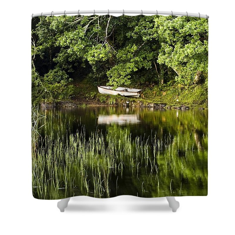 Outdoors Shower Curtain featuring the photograph Rowboat Moored On The Bank Of A Lake by Peter McCabe