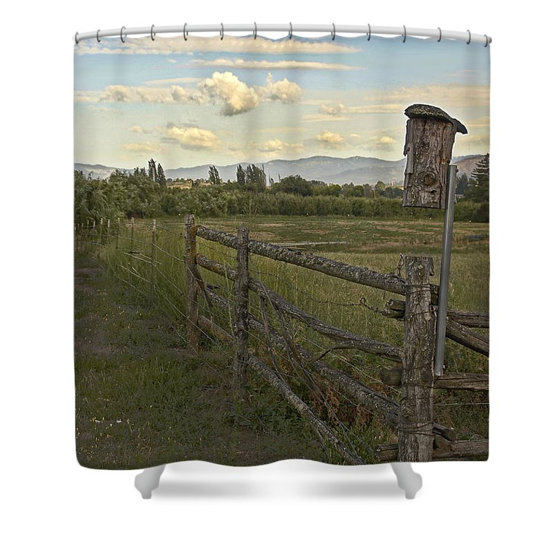 Rural Shower Curtain featuring the photograph Rural Birdhouse On Fence by Mick Anderson