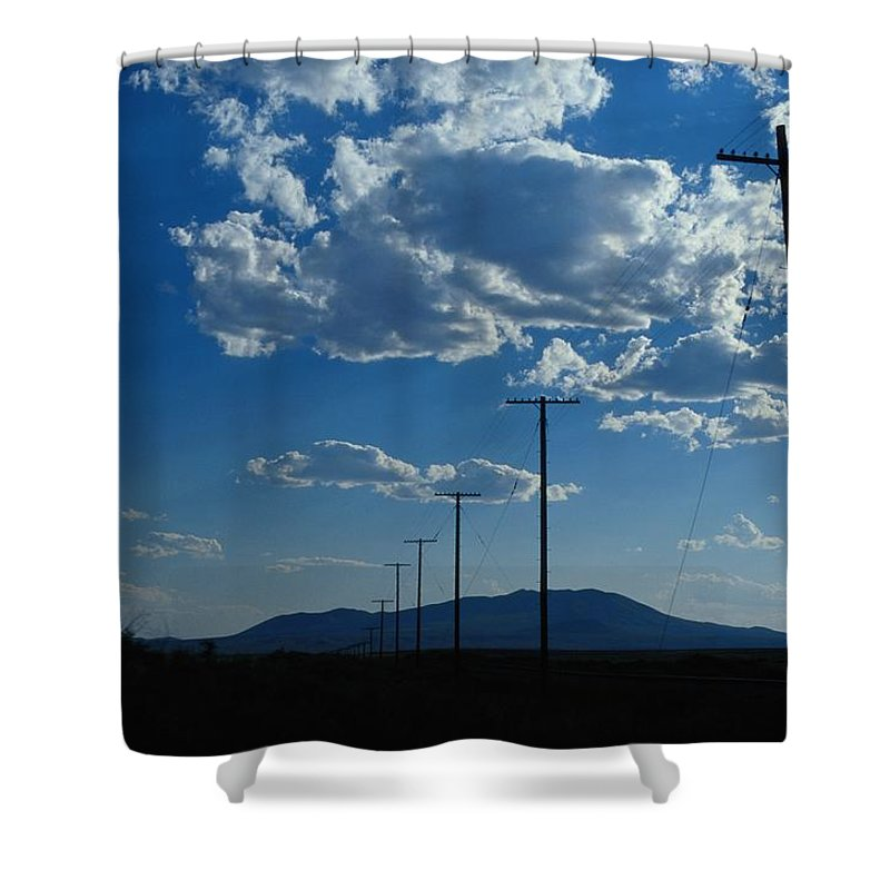 united States Shower Curtain featuring the photograph Silhouetted Telephone Poles Under Puffy by Raymond Gehman