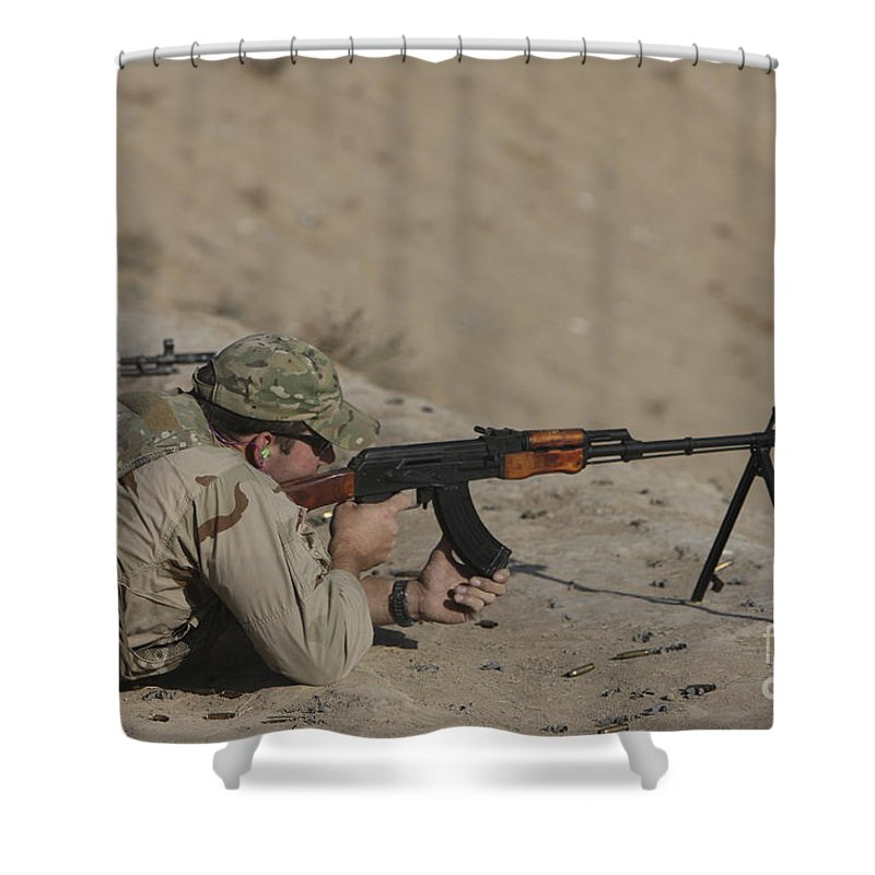 Us Navy Shower Curtain featuring the photograph Soldier Fires A Russian Rpk Kalashnikov by Terry Moore