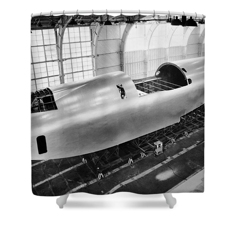 1940's Shower Curtain featuring the photograph Spruce Goose Hull Construction by Underwood Archives