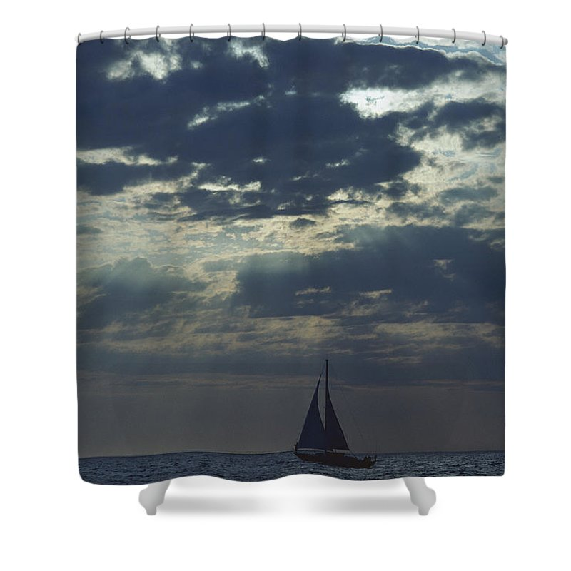 Natural Forces And Phenomena Shower Curtain featuring the photograph Sunlight Breaks Through A Cloudy Sky by Todd Gipstein