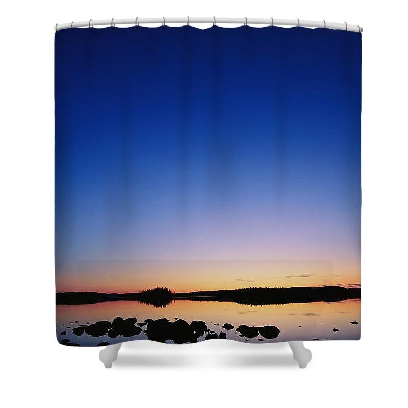 Dalecarlia Reservoir Shower Curtain featuring the photograph Sunset Over Bjorksjon by Mattias Klum