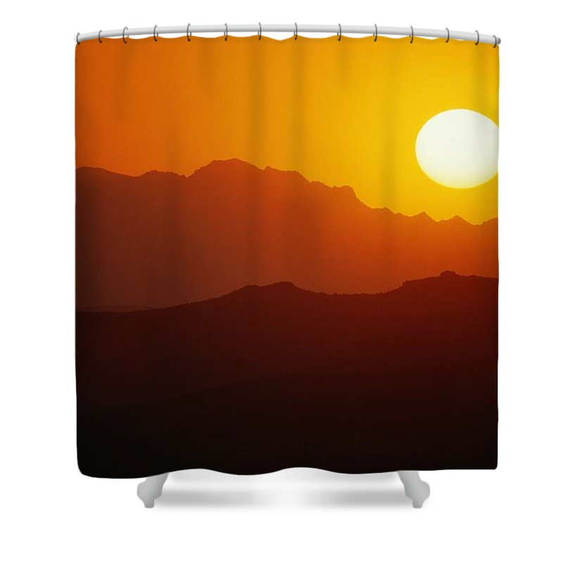 united States Shower Curtain featuring the photograph Sunset Over Silhouetted Mountain Ridges by Raymond Gehman