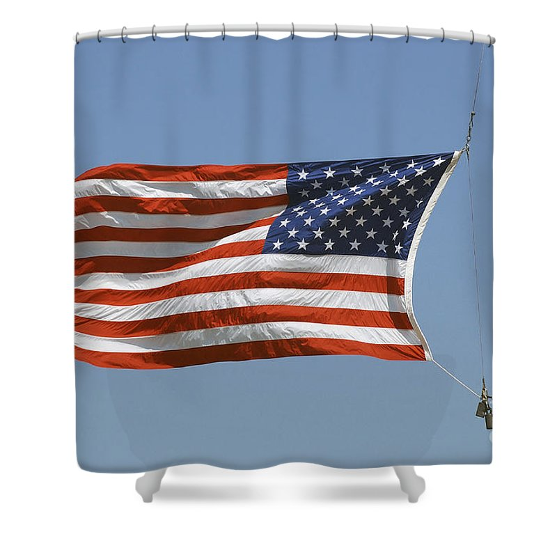 Waving Shower Curtain featuring the photograph The American Flag Waves At Half-mast by Stocktrek Images
