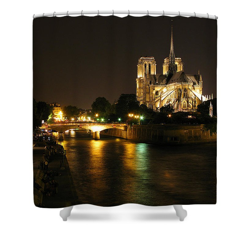 Seine Shower Curtain featuring the photograph The Seine And Notre Dame At Night by Greg Matchick