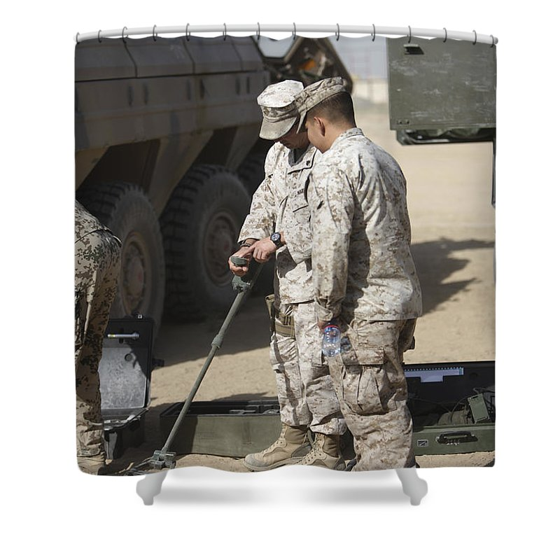 Explosive Ordnance Disposal Shower Curtain featuring the photograph Two U.s. Marines Use A Mine Detector by Terry Moore