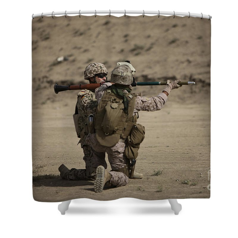 Fragmentation Shower Curtain featuring the photograph U.s. Marines Load A Fragmentation Round by Terry Moore