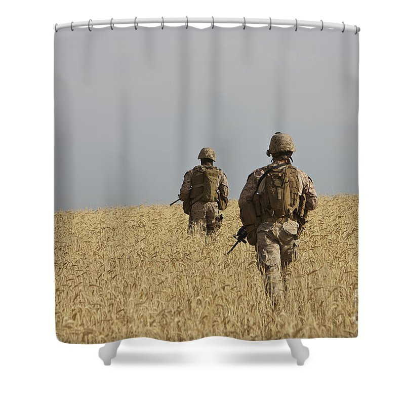Afghanistan Shower Curtain featuring the photograph U.s. Marines Patrol A Wadi Near Kunduz by Terry Moore