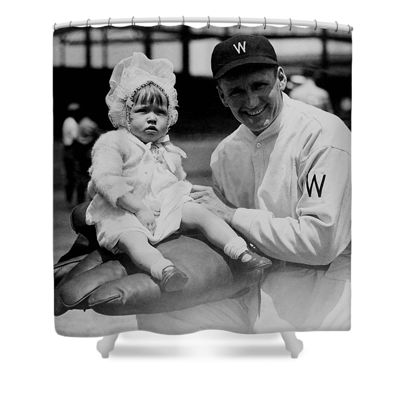 walter Johnson Shower Curtain featuring the photograph Walter Johnson Holding A Baby - C 1924 by International Images