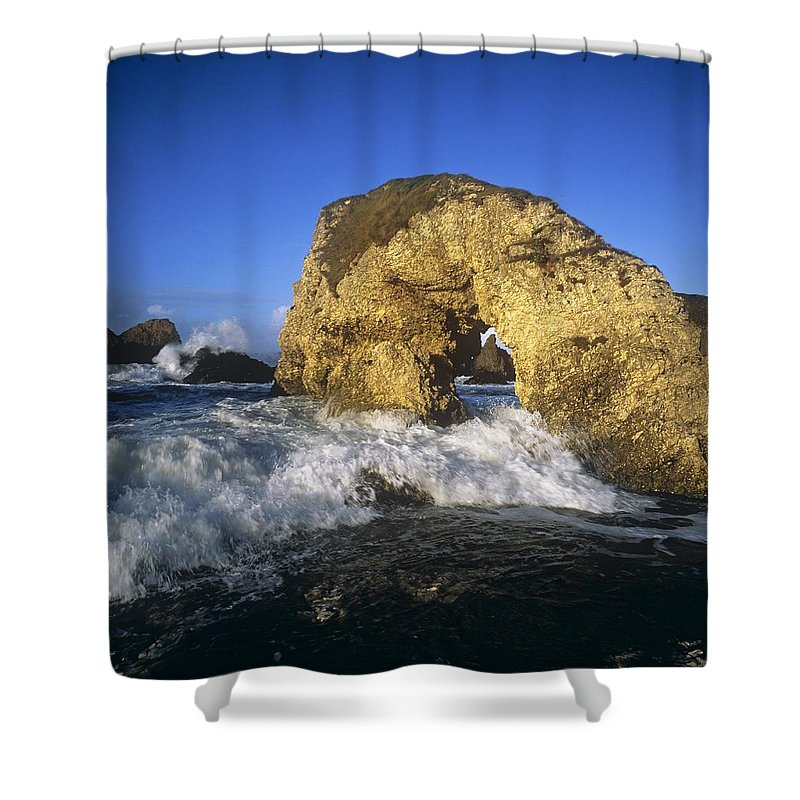 Atlantic Ocean Shower Curtain featuring the photograph Wave Splashing Against Natural Arch by The Irish Image Collection