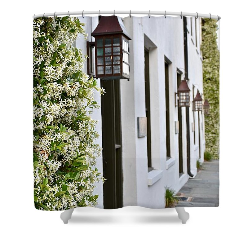 Beautiful House Shower Curtain featuring the photograph Colonial Home Exterior With Vertical Plants And Old Lanterns Displayed On The Side Of Home by Jeramey Lende