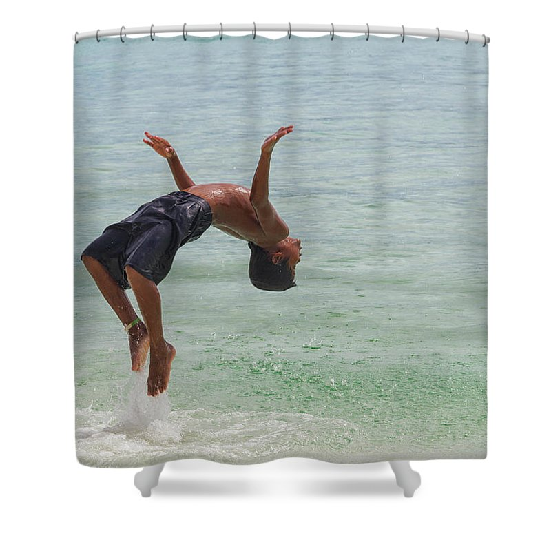 Manila Shower Curtain Featuring The Photograph Kid Doing A Backflip At Beach Of Boracay By