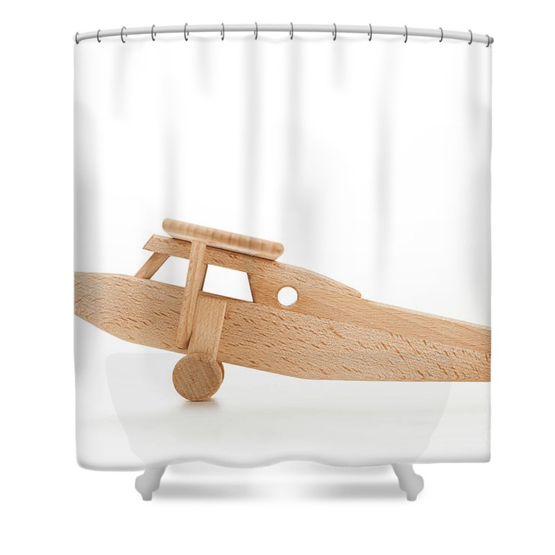 Toy Shower Curtain featuring the photograph Retro Wooden Airplane Isolated On White Background by Michal Bednarek