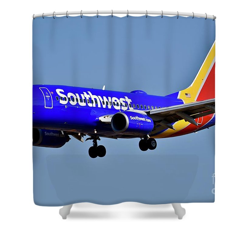 Air Transport Shower Curtain featuring the photograph Southwest Airlines Airplane In Flight by Jeramey Lende