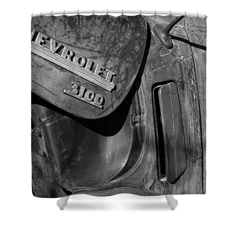 1950 Shower Curtain featuring the photograph 1950 Chevrolet Truck Emblem Black And White by Nick Gray