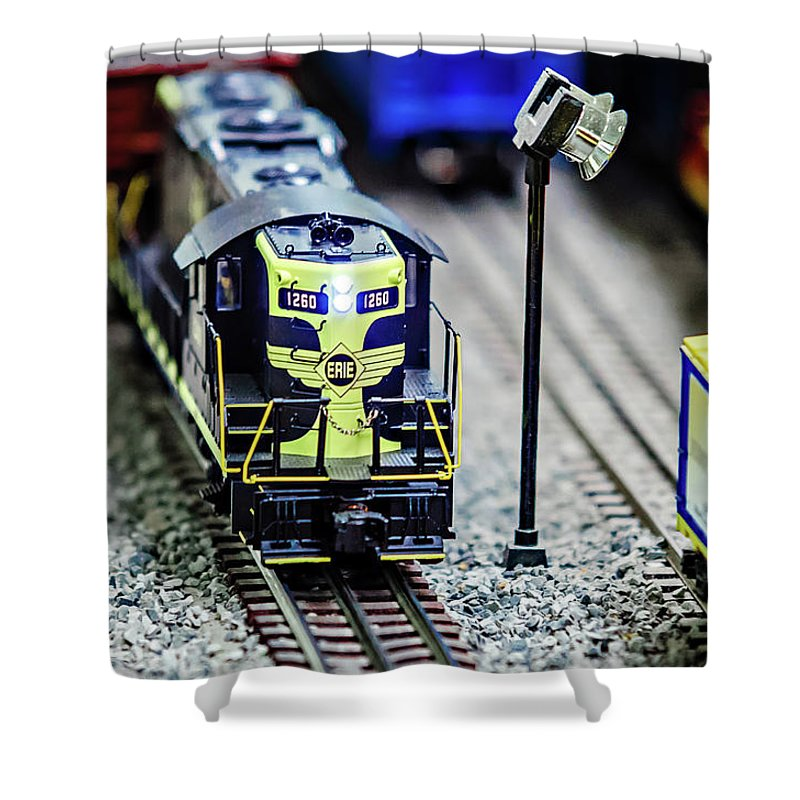 Blur Shower Curtain featuring the photograph Miniature Toy Model Train Locomotives On Display by Alex Grichenko